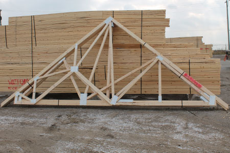 a pile of wood made out of roof truss tops
